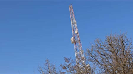 Radio transmission tower under blue sky