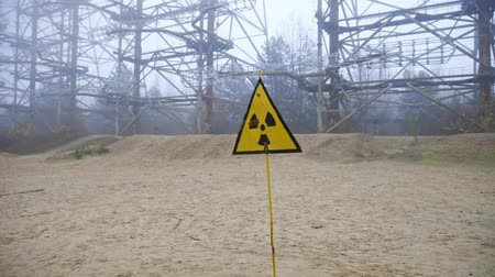 ter cuidado : Beware of radiation sign on the outskirts of Pripyat exclusion zone Stock Footage