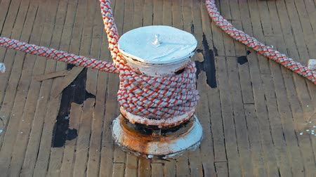 vela : Ropes on wooden ship deck Stock Footage