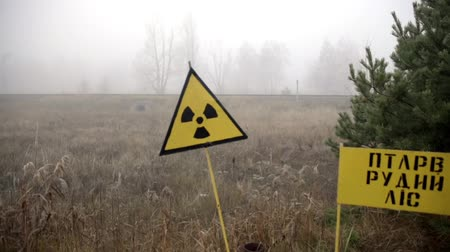 излучение : Beware of radiation sign on the outskirts of Pripyat exclusion zone Стоковые видеозаписи