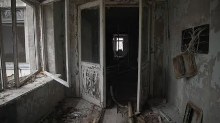 Abandoned corridor in Pripyat, Chernobyl Exclusion Zone 2019 angle shot Stock mozgókép