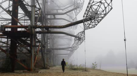 base station : Man walking at Duga Antenna Complex in Chernobyl Exclusion zone 2019