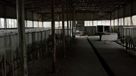 zkorodované : Abandoned industrial interior with breeding tanks angle shot