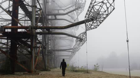 zkorodované : Man walking at Duga Antenna Complex in Chernobyl Exclusion zone 2019