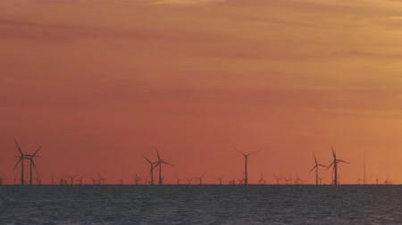 turbine : Wind turbines in the sea under sunset