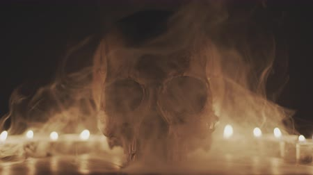 csontok : Skull with smoke and candles Prores 4444 footage Stock mozgókép