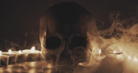 kaars : Skull with smoke and candles in slow motion