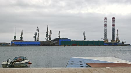 크레인 : Large shipyard from afar with high cranes 무비클립