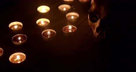 kaars : Candles and skull closeup footage Stockvideo