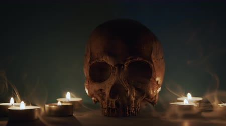 smokey : Skull With Smoke And Candles closeup footage