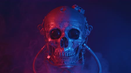 темный фон : Robotic skull in red and blue light with smoke