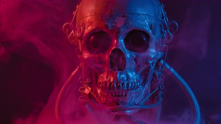 výbava : Robotic skull in red and blue light with smoke