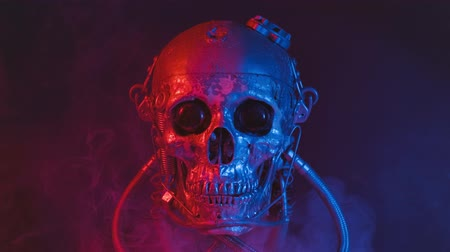 череп : Robotic skull in red and blue light with smoke