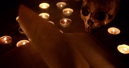 pohanský : Altar with magical grimoire closeup footage