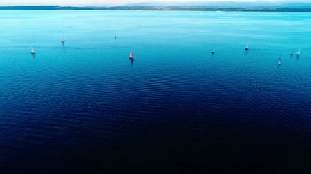 montanhas rochosas : Incredible drone panorama aerial view on small luxury yacht boats sailing slowly in calm deep blue ocean winter seascape