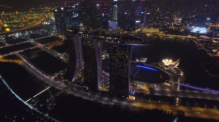 照らさ : Magnificent 4k aerial drone view on big city Singapore by ocean metropolis downtown in bright night light illumination