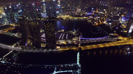 Picturesque 4k aerial drone view on big city Singapore by ocean metropolis downtown in bright night light illumination