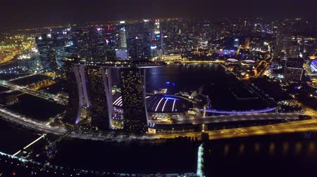 центральный : Amazing 4k aerial drone view on big city Singapore by ocean metropolis downtown in bright night light illumination