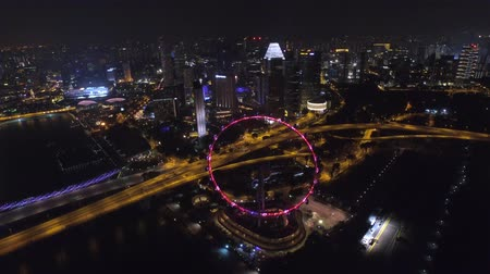 照らさ : Gorgeous 4k aerial drone view on big city Singapore by ocean metropolis downtown in bright night light illumination