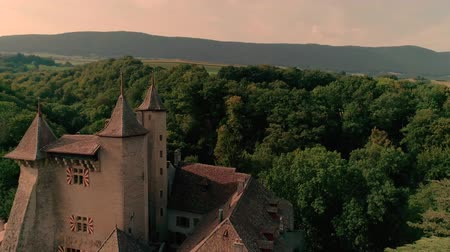 lugares : Marvelous 4k aerial drone panorama view on ancient medieval castle on green hill in province wine yard field landscape