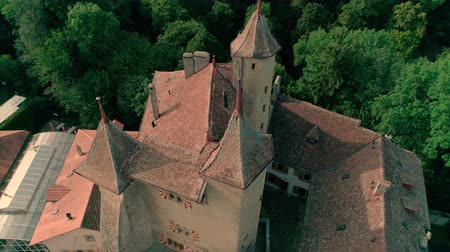 lugares : Stunning 4k aerial drone panorama view on ancient medieval castle on green hill in province wine yard field landscape