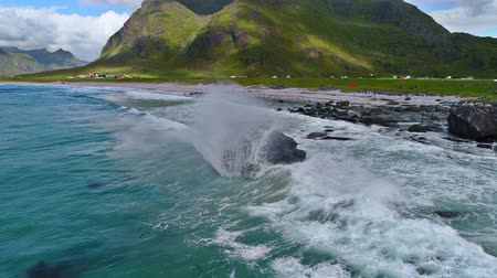 vízfelület : Stunning 4k aerial drone slow motion shot of blue ocean water waves crashing on stones in sand beach mountain landscape