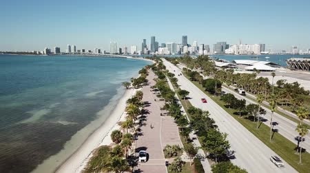 vessels : Fascinating aerial 4k drone panorama flight over huge highway road in big city Miami East Coast ocean coastline seascape