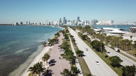 vessels : Magnificent aerial 4k drone panorama flight over huge highway road in big city Miami East Coast ocean coastline seascape