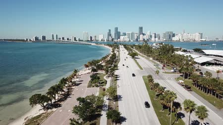 vessels : Picturesque aerial 4k drone panorama flight over huge highway road in big city Miami East Coast ocean coastline seascape