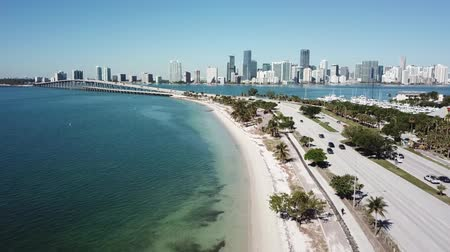 art de rue : Wonderful aerial 4k drone panorama flight over huge highway road in big city Miami East Coast ocean coastline seascape Vidéos Libres De Droits