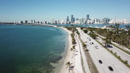 vessels : Beautiful aerial 4k drone panorama flight over huge highway road in big city Miami East Coast ocean coastline seascape