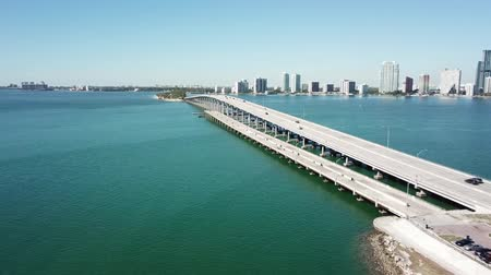 tropikal iklim : Marvelous aerial 4k drone panorama flight over huge highway road in big city Miami East Coast ocean coastline seascape