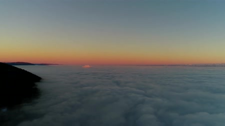 dolu : Fascinating 4k aerial drone flight over sunset sky full of white fluffy clouds in warm orange evening sun light Stok Video