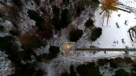 rayos sol : Top aerial drone 4k time lapse shot on flying up above in sky over dark pine tree winter forest covered in snow Archivo de Video