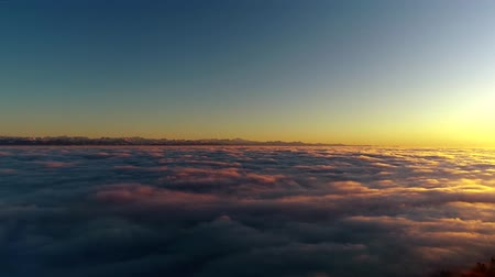 dolu : Wonderful 4k aerial drone flight over sunset sky full of white fluffy clouds in warm orange evening sun light