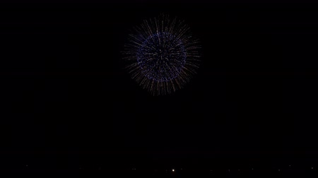 japonya : Gorgeous 4k shot of colorful bright illumination firework festival bursting explosion in dark night sky Stok Video