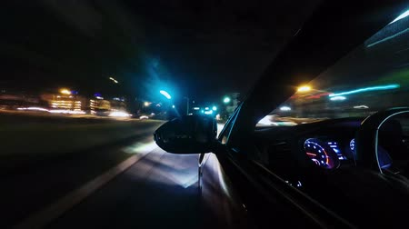 noc : Time lapse amazing 4k view from car windown driving fast on huge highway in bright dark night illumination light