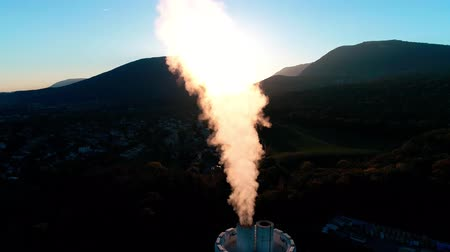 torre : Beautiful aerial drone 4k view on energy power station tower producing bright coloured smoke in dark black night sky Stock Footage