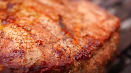 grillowanie : Incredible close up view on fresh fat juicy piece of delicious beef steak pink meat prepared cooked fried on grill pan Wideo