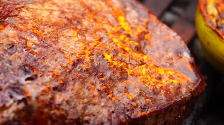 fasola : Beautiful close up view on big fresh fat piece of delicious beef steak pink juicy meat cooked fried grilled on grill pan Wideo