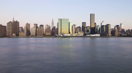 semt : Gorgeous steady day to night time lapse panorama view on evening light illumination on modern towers of New York skyline