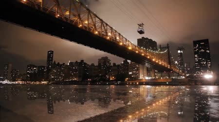 imparatorluk : Magnificent low angle time lapse panorama view on night light illumination on modern Manhattan Brooklyn Bridge cityscape Stok Video