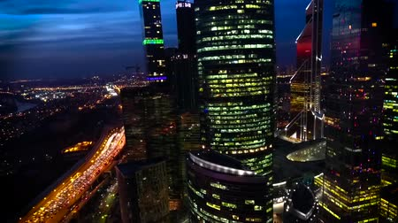 noc : Fascinating aerial drone view on bright evening night Moscow city illumination in busy metropolis downtown cityscape Wideo