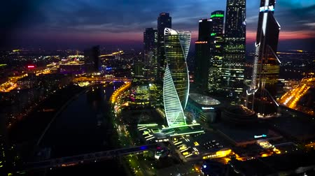 paisagem urbana : Amazing aerial drone view on bright evening night Moscow city illumination in busy metropolis downtown cityscape