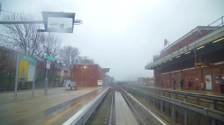 crepúsculo : Time lapse view from railway train on changing location of suburban London on cloudy day Stock Footage