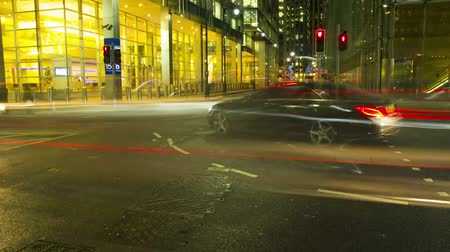 歩道橋 : Time lapse view on busy traffic road highway full of bright light illumination flash in evening night London cityscape