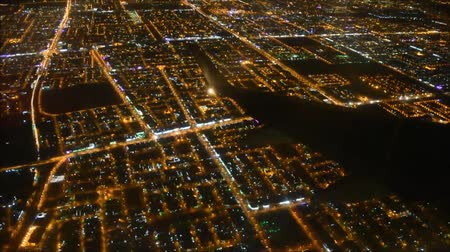fülke : Incredible aerial flight view from passenger air plane wing on bright night big city light illumination dark black sky