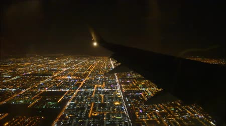 podróż : Impressive aerial flight view from passenger air plane wing on bright night big city light illumination dark black sky