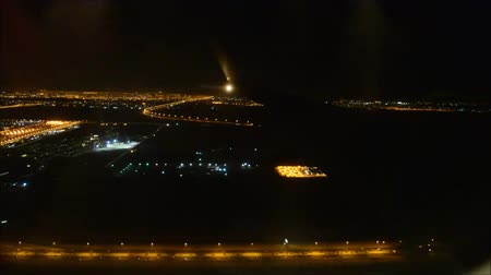 asa : Gorgeous aerial flight view from passenger air plane wing on bright night big city light illumination in dark black sky Stock Footage