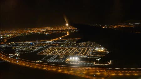 asa : Beautiful aerial flight view from passenger air plane wing on bright night big city light illumination in dark black sky Stock Footage